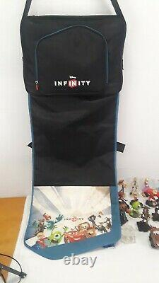 Lot of 28 Disney Infinity Game Figures Toy Story Frozen Cars Pad WithCarring Case